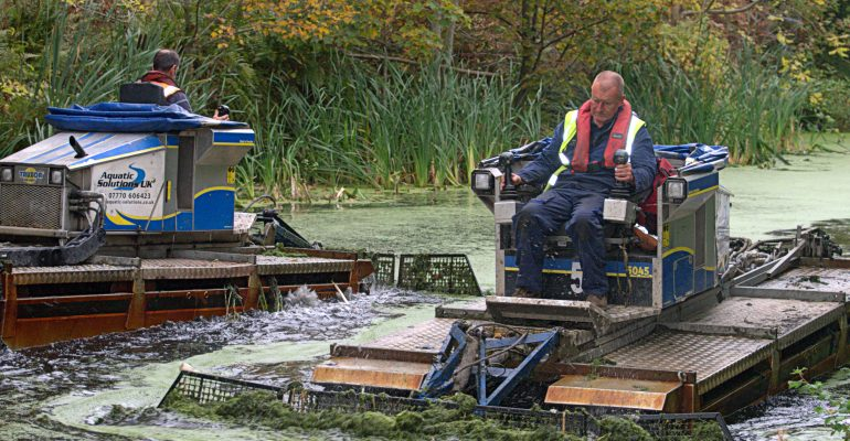 weed boats at work on The Bury to Bolton Canal